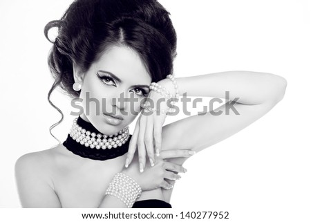 Fashion portrait of beautiful woman with pearls, black and white photo - stock photo
