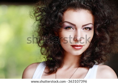 Fashion portrait of beautiful woman with red curly hair and natural makeup enjoying her life in nature. Outdoor shot. Copyspace. - stock photo