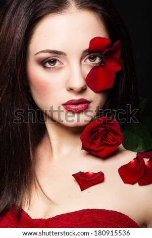 Fashion portrait of beautiful woman with rose petals