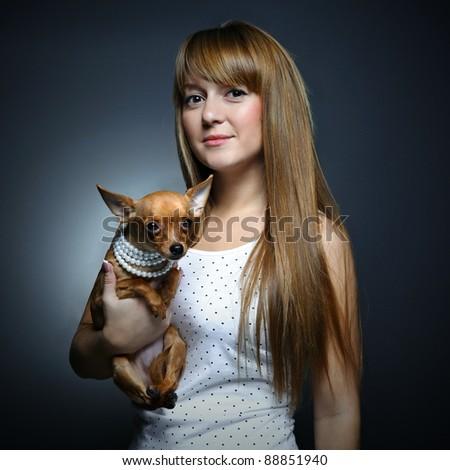 Fashion portrait of beautiful woman with small dog - stock photo
