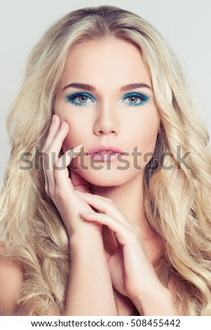 Fashion Portrait of Blonde Woman. Makeup and Curly
