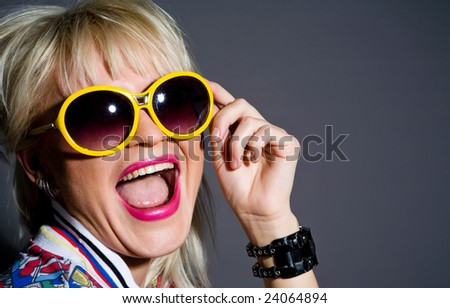 Fashion portrait of crazy blond woman in sunglasses - stock photo