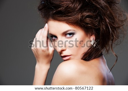 fashion portrait of elegant woman over grey background - stock photo