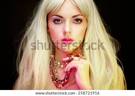 Fashion portrait of elegant woman with magnificent hair. Blonde girl. Jewelry. Perfect make-up