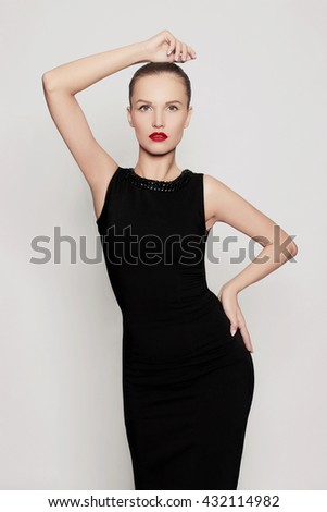 fashion portrait of glamor beautiful young woman in a black dress.beauty sexy girl with red lips - stock photo