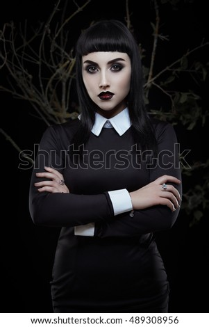 Fashion portrait of mysterious gothic young girl