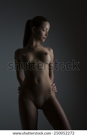 Fashion Portrait Of Naked Woman With Beautiful Slim Body - stock photo