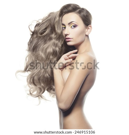 Fashion portrait of nude elegant lady on white background