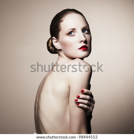 Fashion portrait of nude elegant woman. Studio photo - stock photo