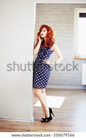 Fashion portrait of red haired girl. - stock photo
