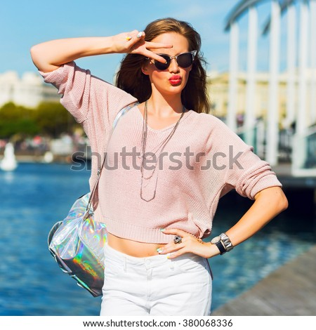 Fashion portrait of sensual amazing l hipster  lady in spring casual pastel outfit , trendy jewels, red lips enjoying holidays in Barcelona. - stock photo