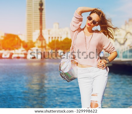 Fashion portrait of sensual amazing lady in  spring casual  pastel outfit , trendy jewels, red lips enjoying  holidays in Barcelona.  - stock photo