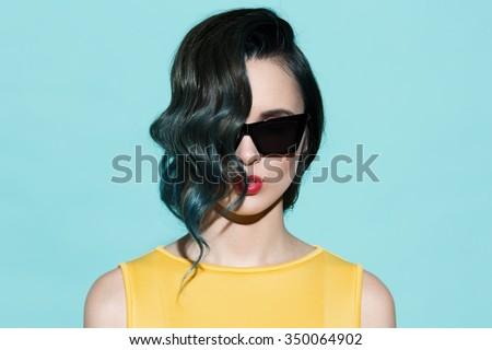 Fashion portrait of sensual stylish woman on a blue background. - stock photo