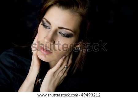 Fashion portrait of sensual young woman on dark background.