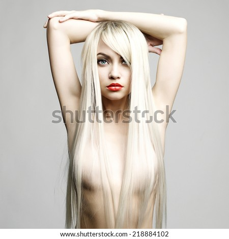 Fashion portrait of sexy blond woman with helthy luxurious hair - stock photo