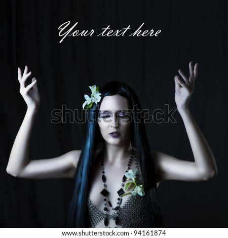 Fashion portrait of sexy woman - witch or elf. Hands up - stock photo