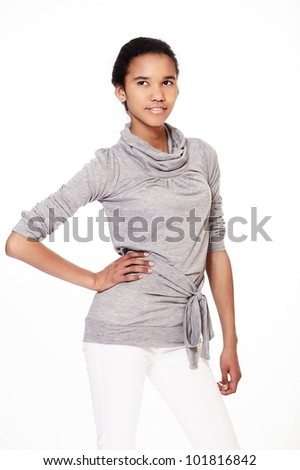fashion  portrait of stylish smiling casual young female beautiful black american girl in gray and white cloth against white background - stock photo