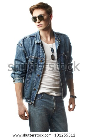 Fashion portrait of the young  man wearing jeans jacket - stock photo