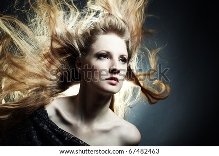 Fashion portrait of the young sexy woman with flying hair - stock photo