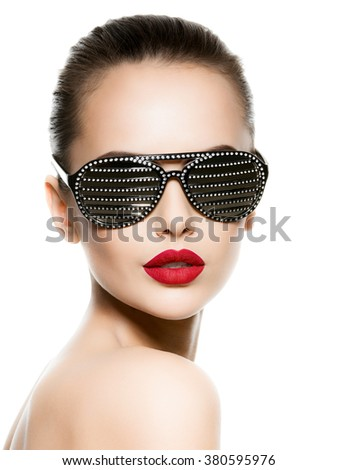 Fashion portrait of  woman wearing black sunglasses with diamonds and red lips - stock photo