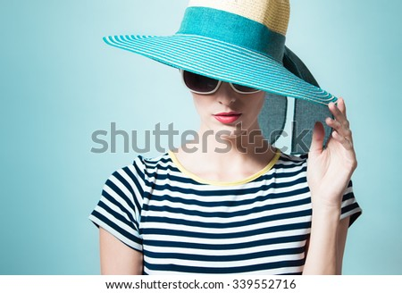 Fashion portrait of woman wearing hat - stock photo