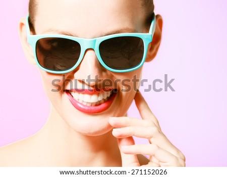 Fashion portrait of woman wearing sunglasses.  - stock photo