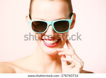 Fashion portrait of woman with sunglasses smiling.  - stock photo
