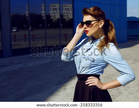 Fashion portrait of young beautiful and sexy brunette girl in trendy casual clothes. Vogue style. Outdoor shot. Street fashion concept - stock photo