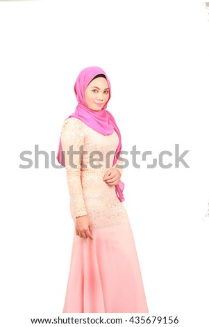 Fashion portrait of young beautiful asian muslim woman with wearing hijab smile while standing against white background. Selective focus - stock photo