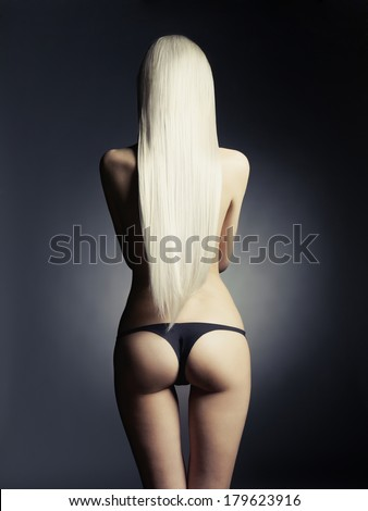 Fashion portrait of young beautiful blonde with healthy hair - stock photo