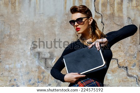 Fashion portrait of young beautiful brunette girl in trendy casual clothes and sunglasses. Vogue style. Outdoor shot - stock photo