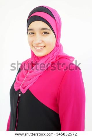 Fashion portrait of young beautiful muslim girl wearing hijab - stock photo