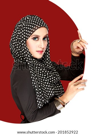 Fashion portrait of young beautiful muslim woman with black scarf - stock photo