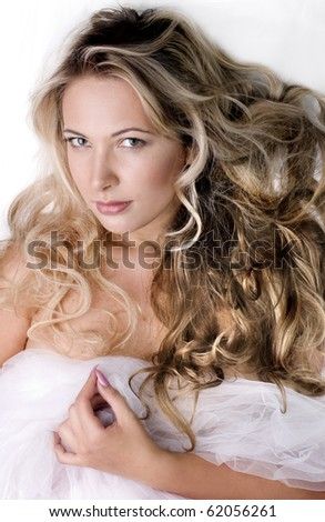 Fashion portrait of young  beautiful woman in bed - stock photo