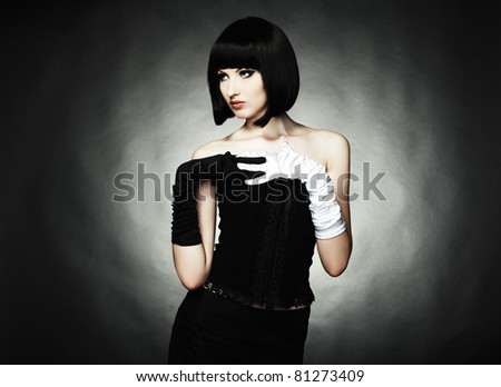 Fashion portrait of young beautiful woman in the black dress - stock photo