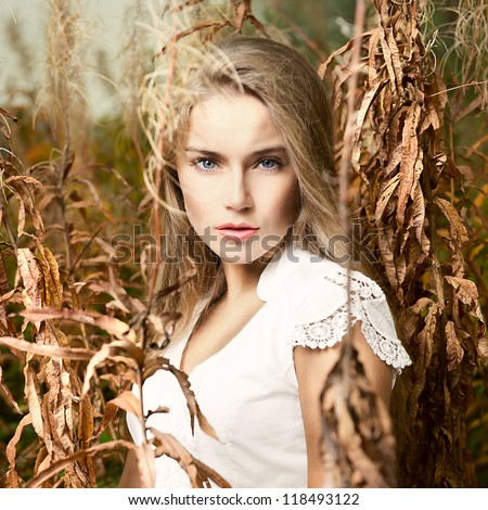 Fashion portrait of young beautiful woman  posing in nature - stock photo
