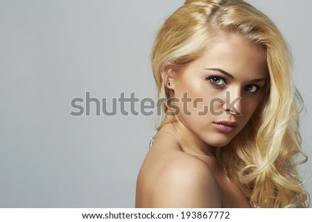 Fashion portrait of young beautiful woman.Sexy Blond girl. Gray Background.Your text here - stock photo