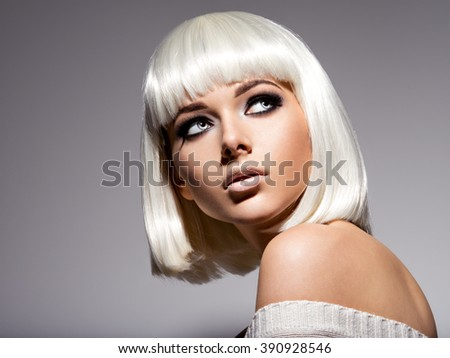 Fashion portrait of young beautiful woman with hairstyle bob and black makeup of eye - stock photo