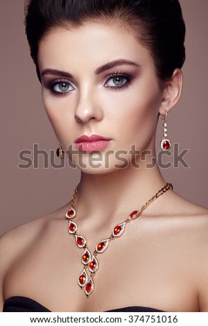 Fashion portrait of young beautiful woman with jewelry. Brunette girl. Perfect make-up.  Beauty style woman with diamond accessories - stock photo