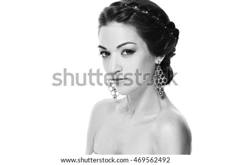 Fashion portrait of young beautiful woman with jewelry. Brunette girl. Perfect make-up.  Isolated on white background.