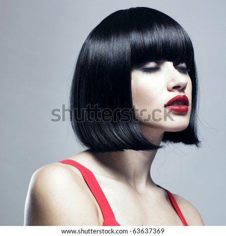 Fashion portrait of young beautiful woman with strict hairstyle