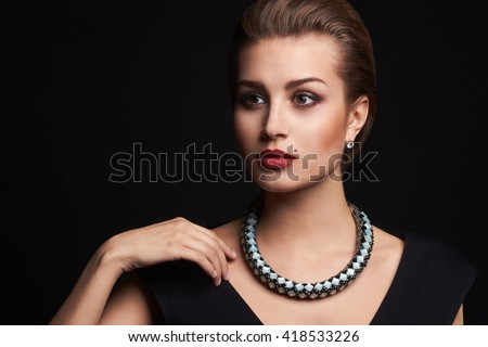 fashion portrait of young beautiful young woman in jewelry.Beauty girl with short hair and make-up.elegant lady