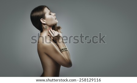 Fashion portrait of young brunette woman in profile