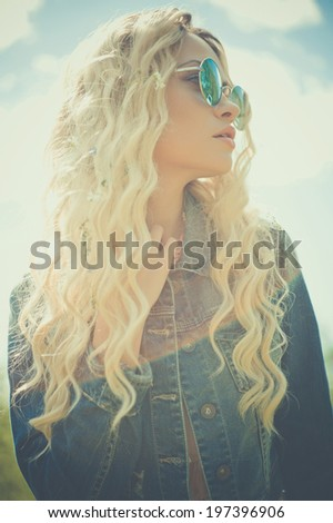 Fashion portrait of young hippie woman in summer sunny day - stock photo