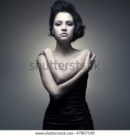 Fashion portrait of young magnificent lady in black dress - stock photo