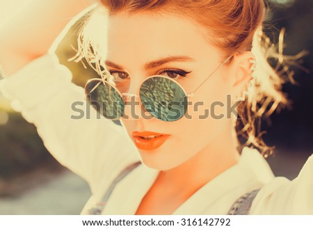 Fashion portrait of young sensual blonde woman with long amazing curled ombre hairs, natural make up.Sort vintage colors - stock photo
