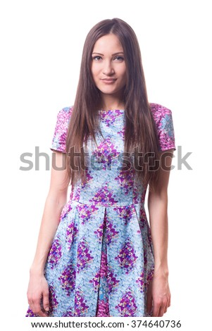 Fashion portrait of young woman with long hair. Shapely model in studio stands isolated on white background. Pretty, beautiful and attractive girl in bright shot summer dress.