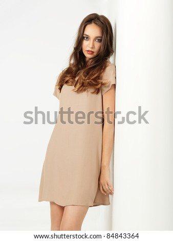 fashion portrait sexy young woman beige dress
