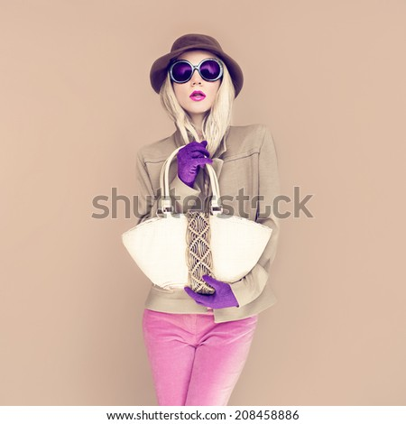Fashion portrait trendy girl in stylish hat - stock photo
