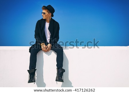 Fashion portrait young man in hipster fashion style - stock photo